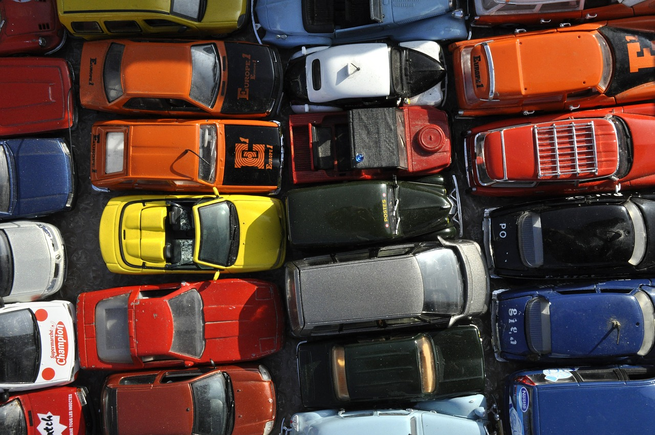 Small cars standing in a few rows