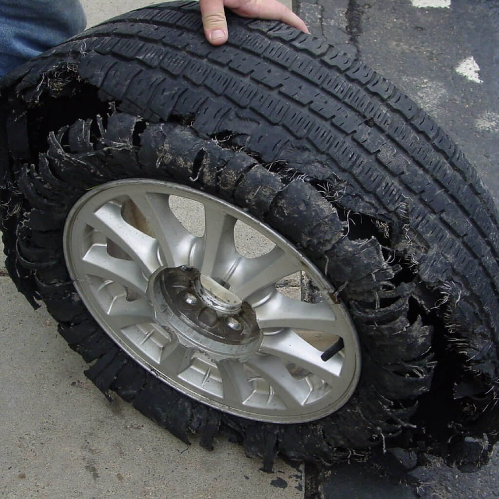 Tire bulge - ripped tire